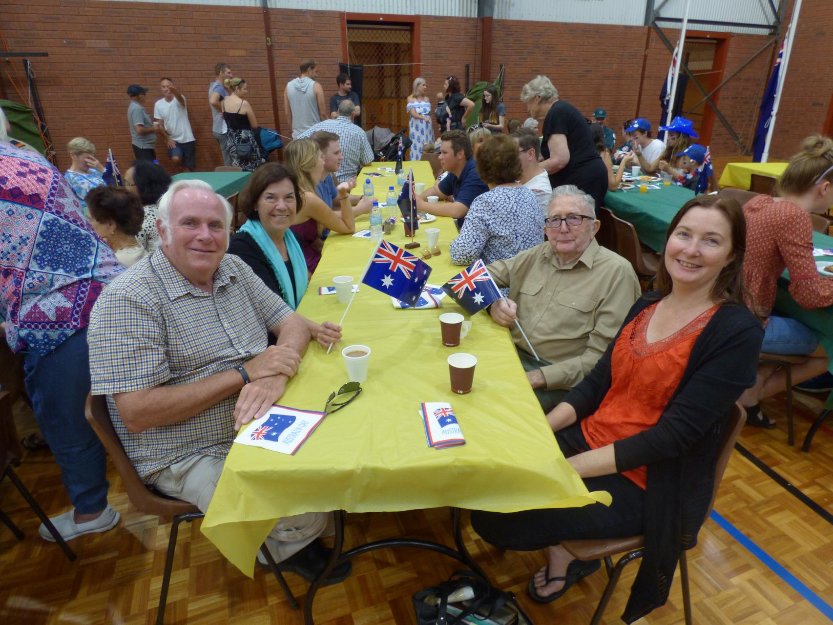 Community members enjoy their breakfast and a chat